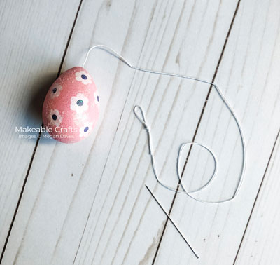 Easter Egg Craft | Tie off a loop on one end
