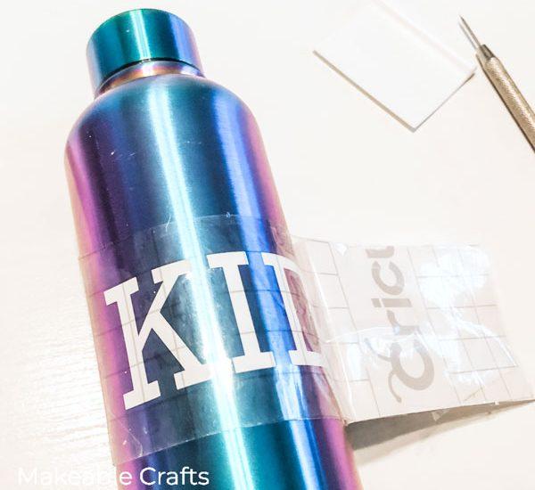 Custom Water Bottles   apply the vinyl
