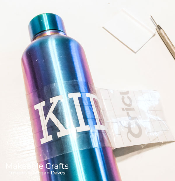 Custom Water Bottles | apply the vinyl