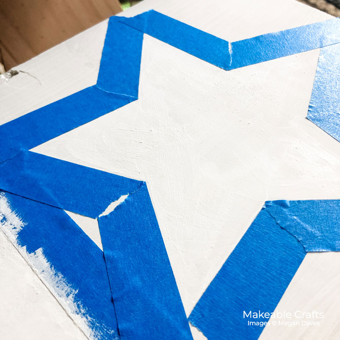 use painters tape around the edges of your star