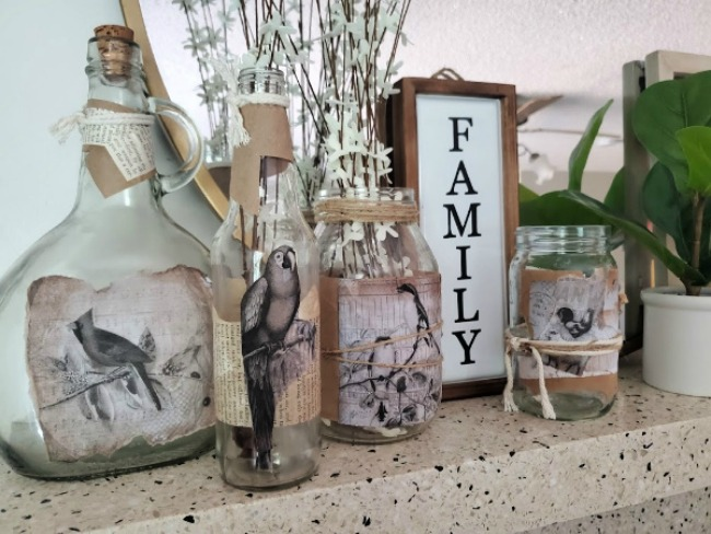 If you are a fan of making recycled crafts for home decor you have to check out this collection of glass bottles repurposed with paper!