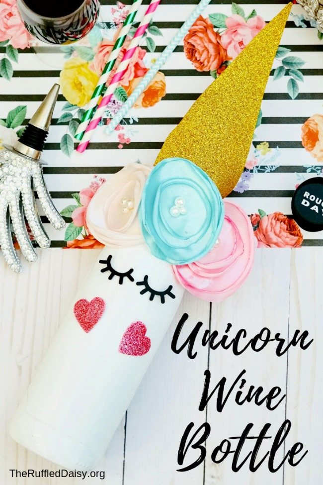 Can you believe this unicorn gift was made with a wine bottle and some recycled crafts supplies?