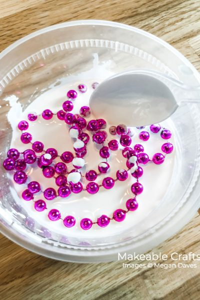 add your mardi gras beads to your paint and water mixture