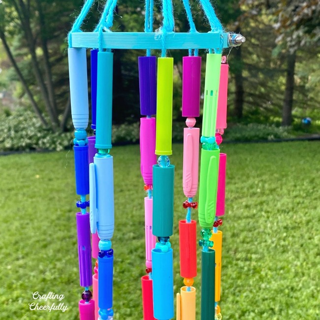 Recycled crafts from old orpahned pen caps - easy for the kids and colorful for the yard!