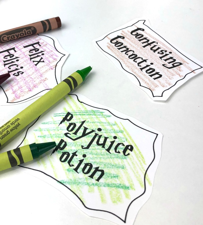 Use plain old crayons to color in the labels for your DIY Harry Potter potion bottles!