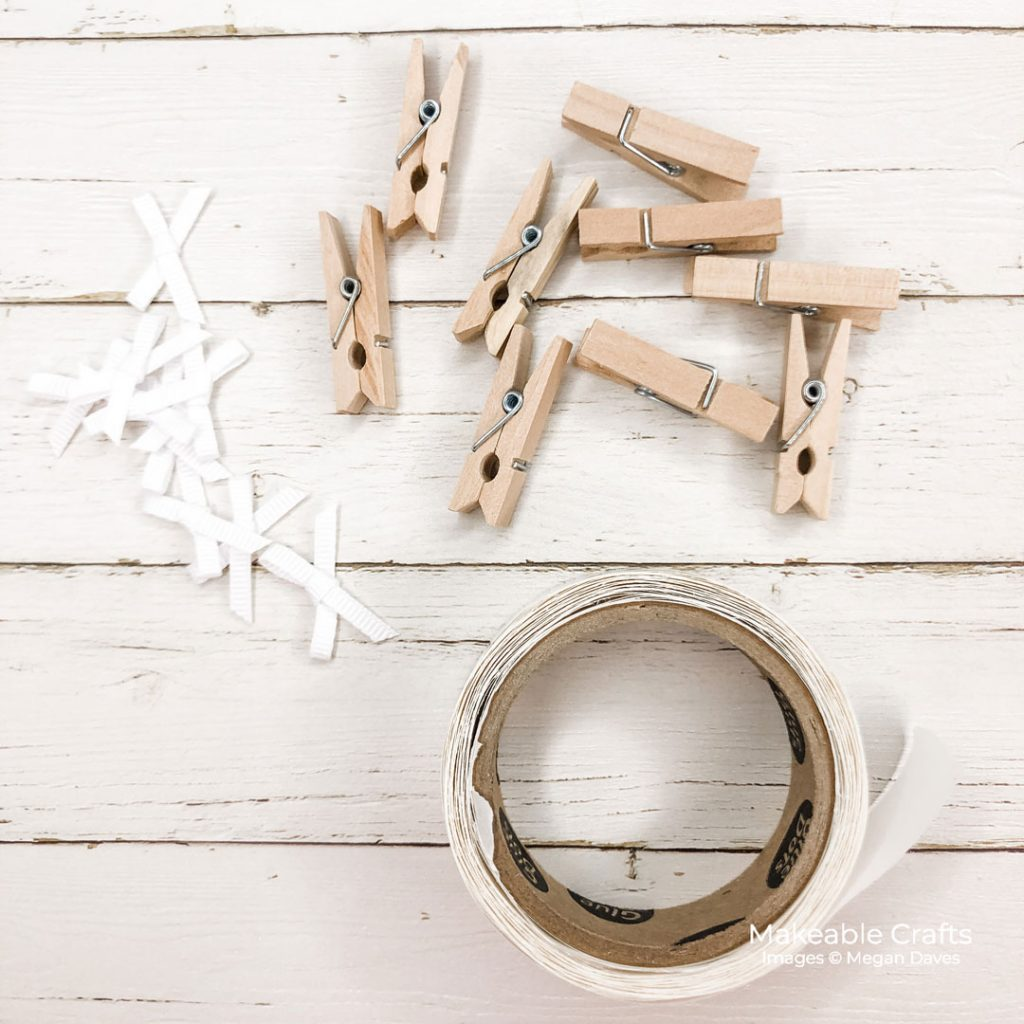 Mini clothespins, tiny bows and adhesvie to be used on a DIY fall home decor decorative wall sign