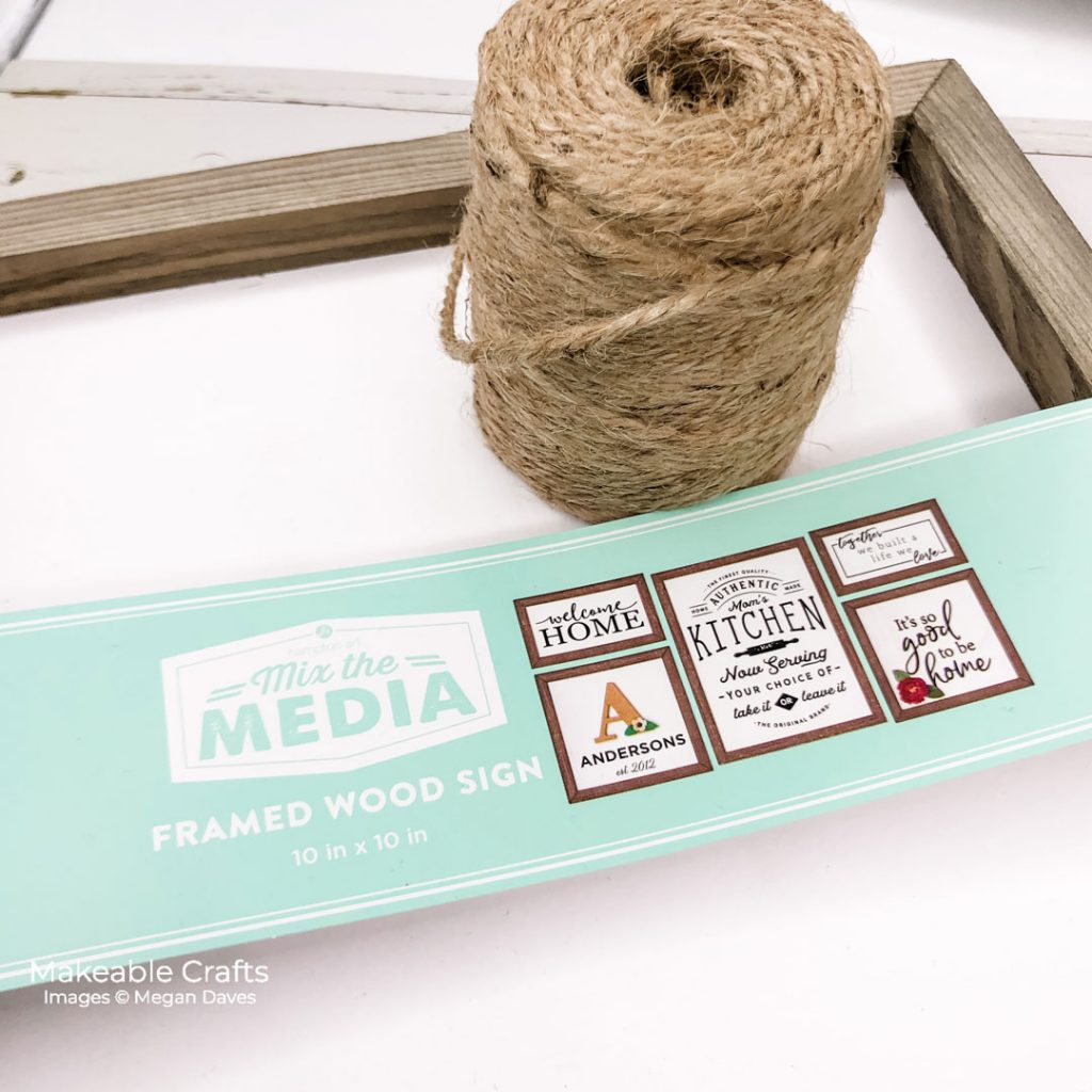 Thick twine and a basic wood sign about to be turned into an adorable piece of DIY fall home decor