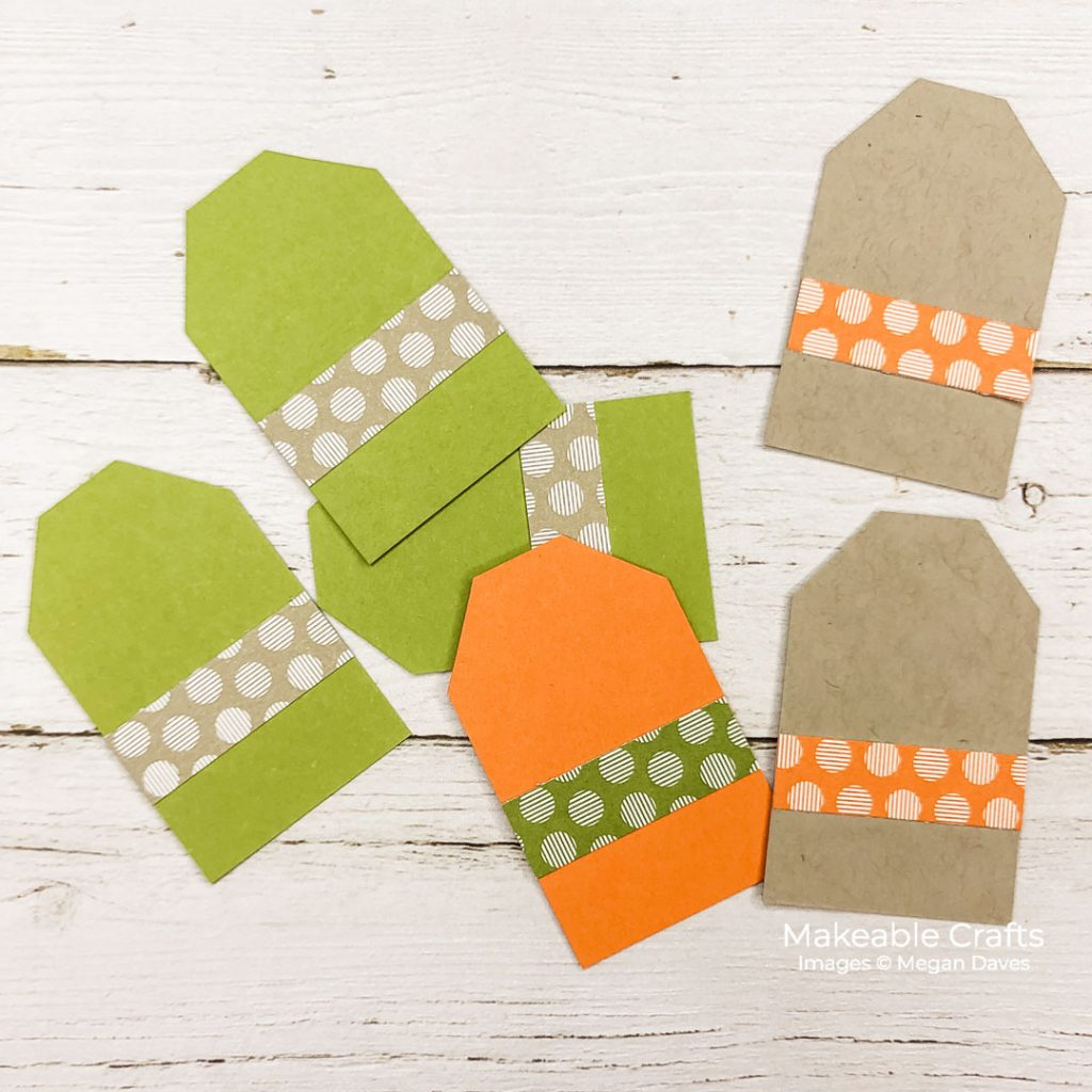 Colorful paper tags to be used as letter backgrounds for a quick and easy piece of DIY fall home decor