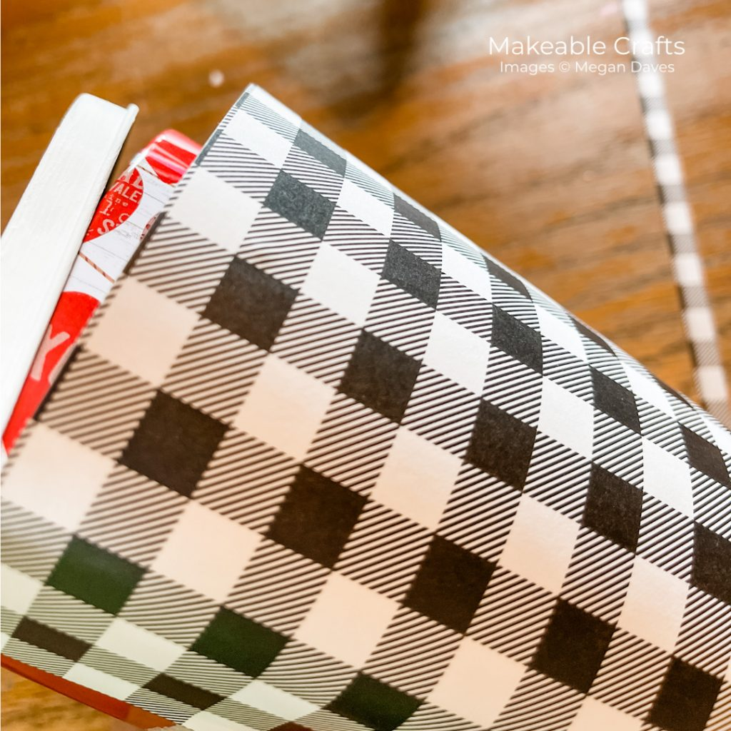 wrap your patterned paper around your mini mailbox for this dollar store craft